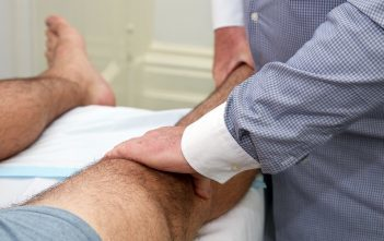 Sports Injury Doctor examining patient