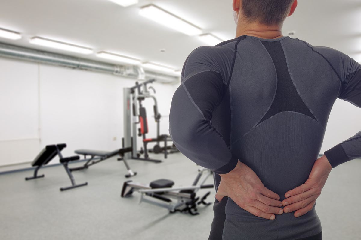 Man with low back injury in gym